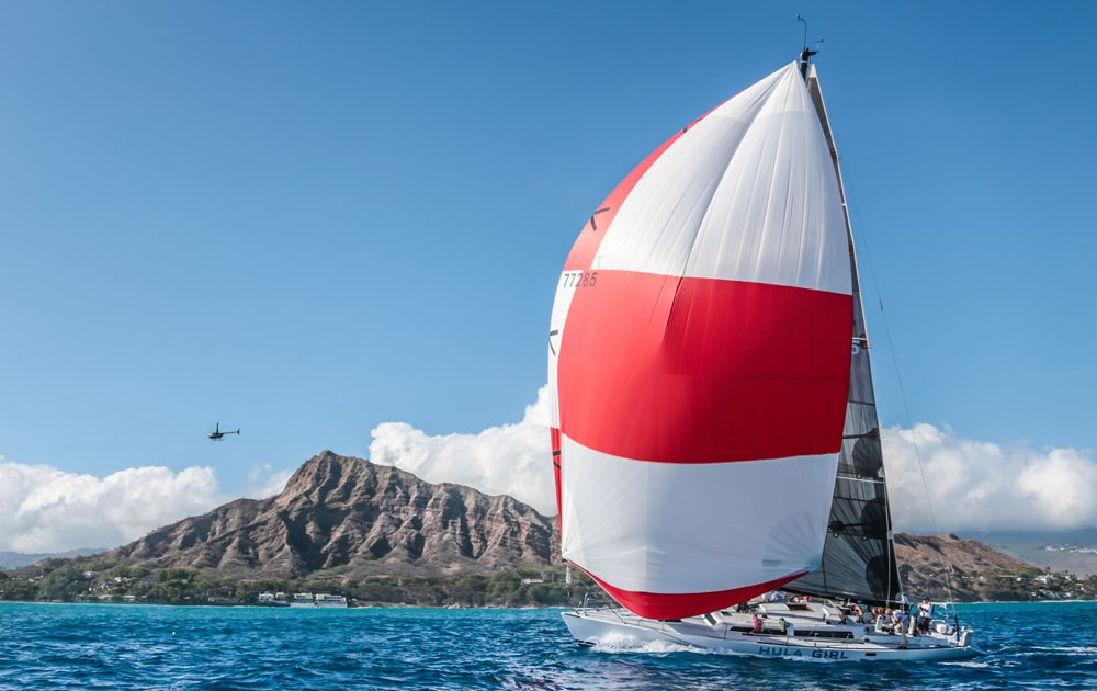 J World's Hula Girl cruising past Diamond Head the end of the Transpac, July 2015. Photo Credit: Lauren Easley, http://www.leialohacreative.com